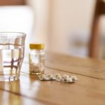 Pills Glass of Water on Table - Medicare Part D Coverage