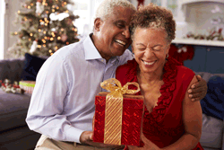 Senior Couple Giving Presents