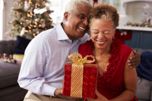 Couple with Gift - Medicare Supplement Colorado