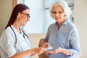Nurse helping patient with Prescription Medication