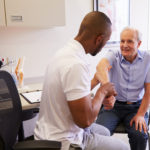 Male Doctor working with Patient Colorado